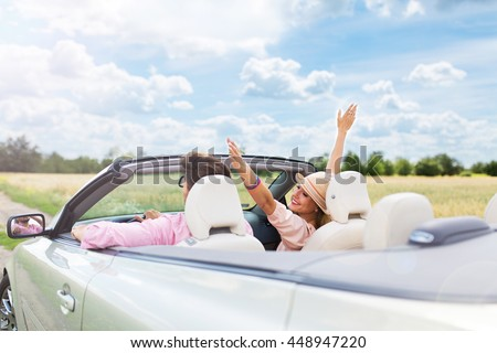 Couple enjoying a drive in a convertible Stock photo © Lopolo