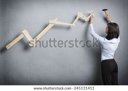 Young businesswoman building pointing up chart. Stock photo © lichtmeister
