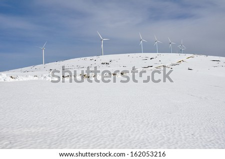 aerogenerator windmills on snow mountain stock photo © lunamarina