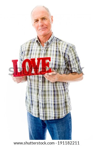 Senior man tonen Rood liefde tekst Stockfoto © bmonteny