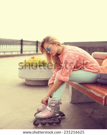 Stylish woman in rollers posing on bench Stock photo © dash