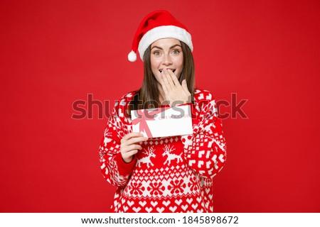 Santa Holding a Gift Stock photo © CrackerClips