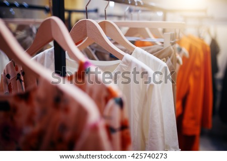 fashion clothing on hangers in a shop stock photo © stockyimages