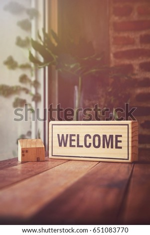 Welcome on wooden table Stock photo © fuzzbones0