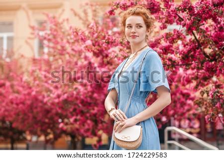 Smiling woman holding shoulder bag Stock photo © wavebreak_media