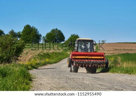 Farmer and corn crop pile after harvest Stock photo © simazoran