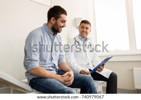 doctor with clipboard and male patient at hospital Stock photo © dolgachov