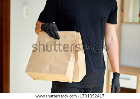 Courier hold go box food, delivery service, Takeaway restaurants food delivery to home door Stock photo © Illia