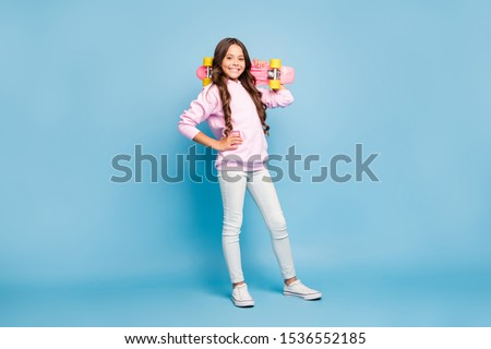 Casual trendy young woman with her skate board Stock photo © dash