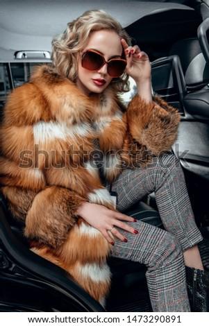 Fashionable blonde lady posing. Stock photo © NeonShot