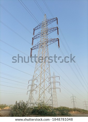 electric pylons transporting electricity through high tension ca Stock photo © meinzahn