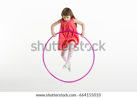 A girl jumping with a plastic hoop Stock photo © IS2