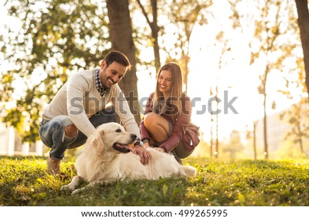 Stockfoto: Paar · spelen · hond · park · vrouw · man