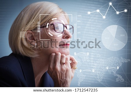 Side view of thoughtful senior Caucasian businesswoman looking through window in modern office build Stock photo © wavebreak_media
