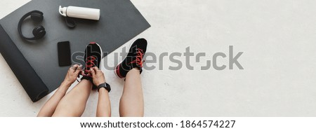 sports top, mat, fitness tracker and water bottle Stock photo © dolgachov
