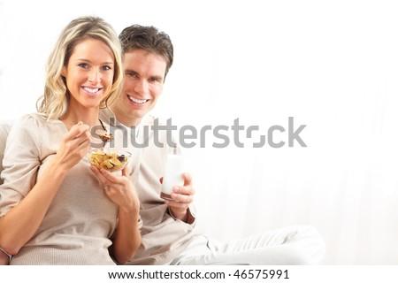 Couple eating breakfast on the sofa Stock photo © photography33