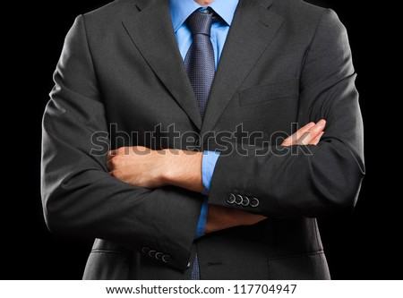 Stock photo: Closeup image of a business man with folded arms