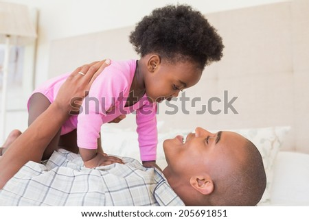 Father playing with adorable baby girl in bedroom Stock photo © Lopolo