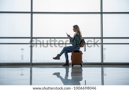 A woman travels and sits waiting for the departure of a tourist boat from the sea Bay Stock photo © ElenaBatkova