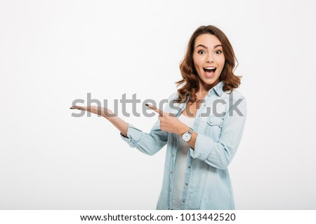 happy casual young people pointing fingers stock photo © feedough