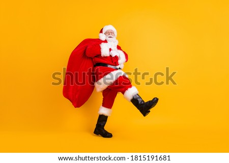 side view of fat merry santa claus walking stock photo © feedough