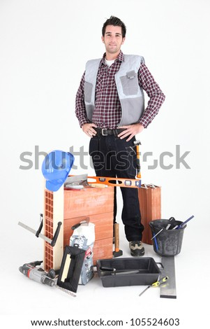 Brick layer proudly standing by his equipment Stock photo © photography33