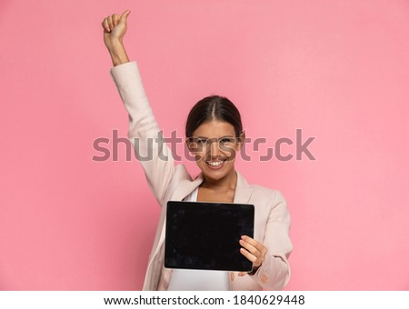 Smiling young female presenting her laptop screen against a white background Stock photo © wavebreak_media