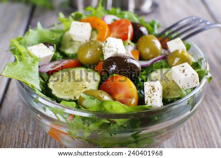 Greek salad with vegetables, garnished with basil. Stock photo © dariazu