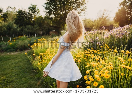 Young Woman with Long Blond Hair in Yellow Dress. Stock photo © courtyardpix