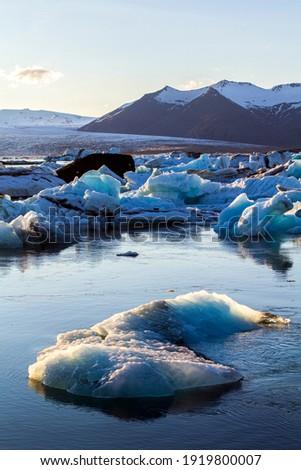 Ice floes at glacier lagoon Jokulsarlon in the evening sun Stock photo © kb-photodesign