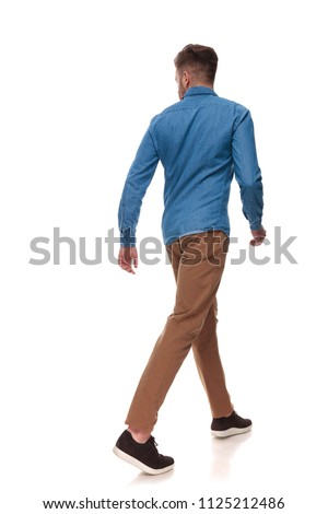 back view of fitness man walking and looking to side Stock photo © feedough
