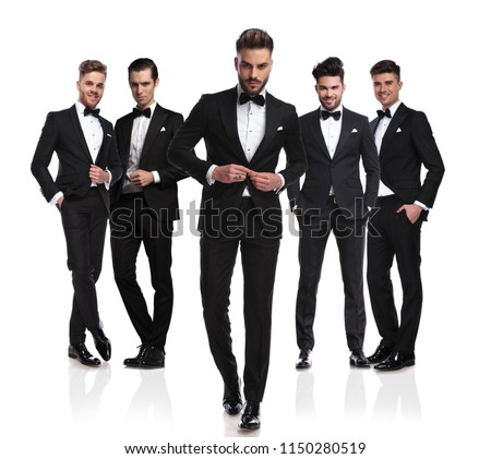 relaxed happy businessman wearing a black tuxedo walks Stock photo © feedough