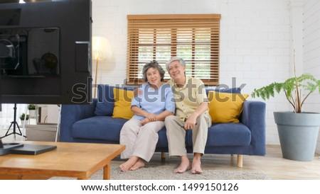 пару сидят вместе диван домой пультом Сток-фото © Lopolo