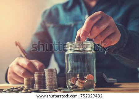 Saving jar with coins Foto stock © szefei
