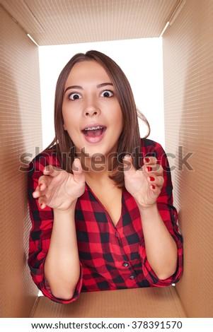 happy girl taking something out of open gift box Stock photo © dolgachov