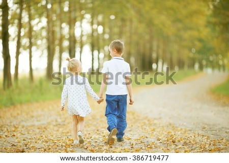 Children brother and sister walk in the autumn yellow forest dressed in French Provence style Stock photo © ElenaBatkova