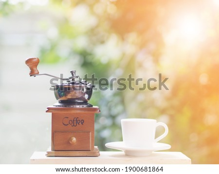 coffee wooden grinder  and beans and white  cup Stock photo © OleksandrO