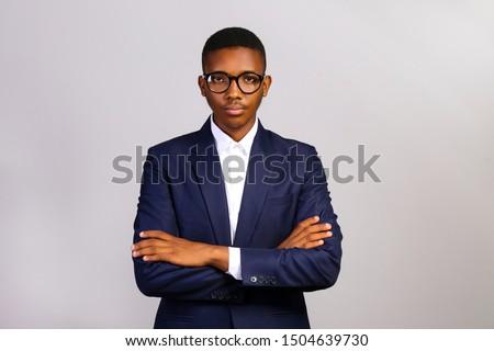 Attractive afro-american business man posing in studio Stock photo © bmonteny