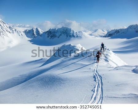skier hike on mountain peak at winter Stock photo © dotshock