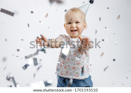 laughing little girl in blue dress is clapping her hands stock photo © feedough