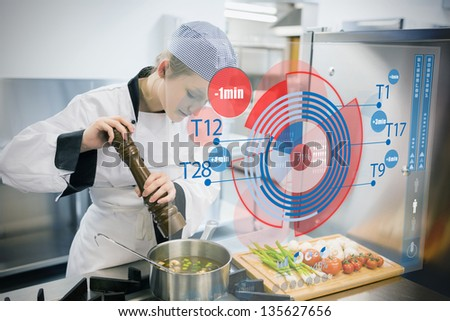 chef cooking for a restaurant with futuristic interface stock photo © wavebreak_media