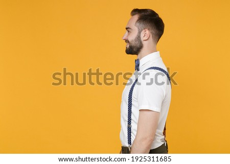 Portrait of smiling european man with tied hair looking aside, w Stock photo © deandrobot