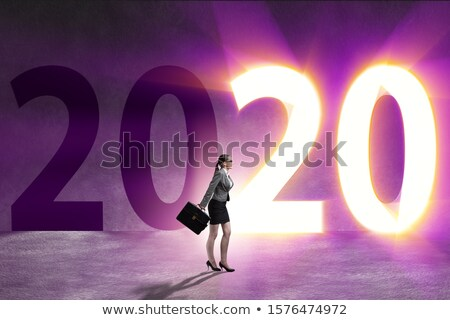 Businesswoman in the concept of transition to year 2019 Stock photo © Elnur