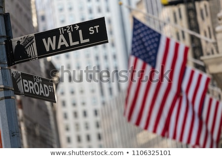 Street sign for Wall Street with the American Flag at the background Stock photo © johnkwan