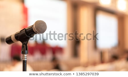 Stock photo: Microphone voice speaker with audiences or students in seminar classroom, lecture hall or conference