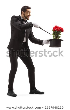 young magician performing red rose Stock photo © vladacanon