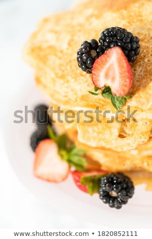 Freshly prepared crepes with raspberries  Stock photo © danielgilbey
