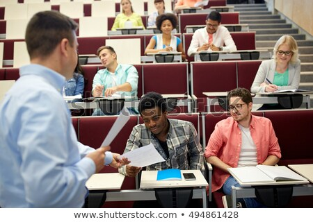 teacher giving tests to students at lecture Stock photo © dolgachov