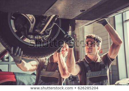 Mechanic Examining Car Wheel Stock photo © AndreyPopov