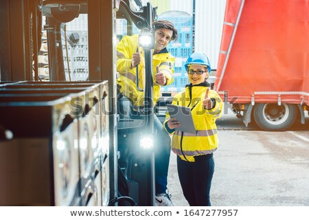 Forklift driver and forewoman discussing where to store delivery Stock photo © Kzenon